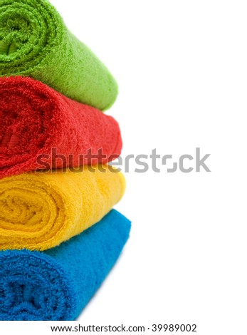 Colorful towels isolated on white background - stock photo