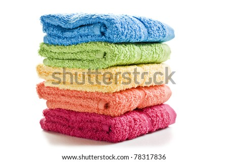 Colorful towels on a white background with space for text - stock photo