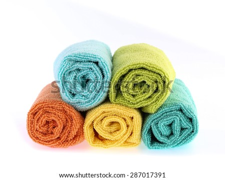 Colorful towels rolls isolated on white background.
