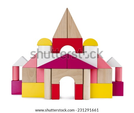 Colorful tower castle from toy bricks isolated on white - stock photo