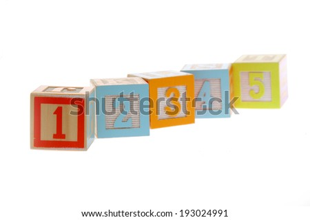 Colorful toy blocks with numbers from one to five for learning mathematics/Baby Cubes from 1 to 5 isolated on white