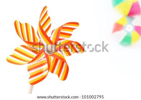 Colorful toy pinwheel on white background - stock photo