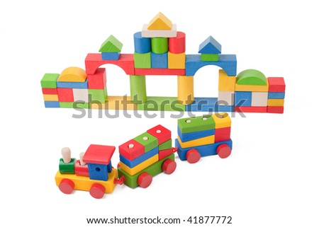 Colorful toy train and toy blocks isolated on white background - stock photo