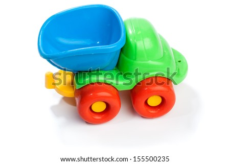 Colorful toy truck from plastic for kids. Studio shot, isolated on white background.