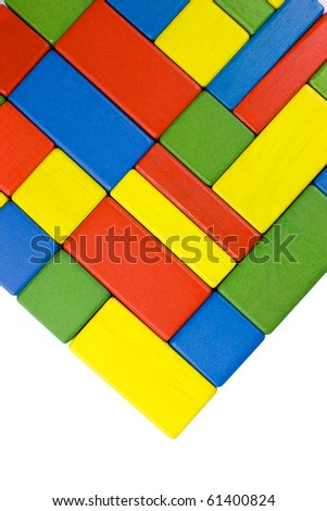 Colorful toy wooden square and rectangular blocks in red, green, yellow and blue - background. - stock photo