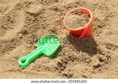 Colorful toys for children's sandboxes on the sea beach - stock photo