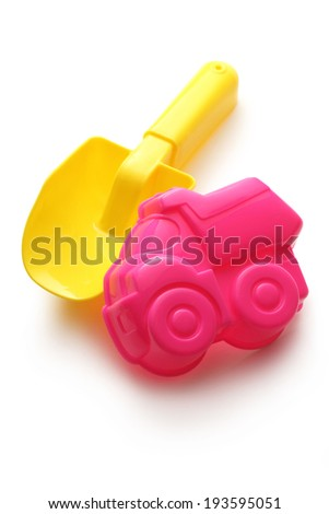 Colorful toys for playing in sandbox - stock photo