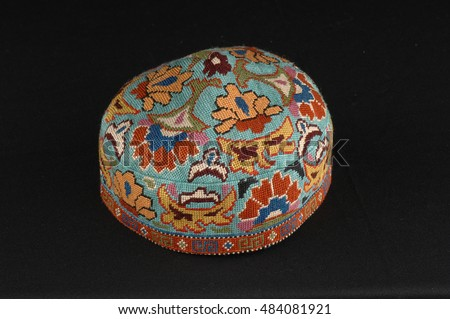 colorful traditional asian skullcap cap on a dark background