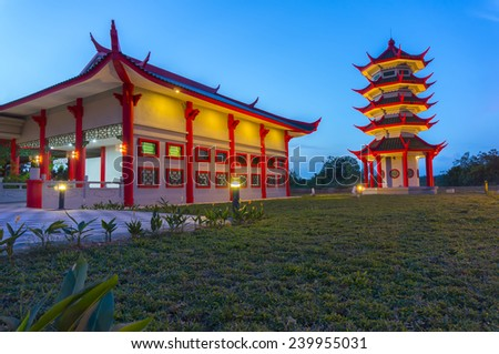 colorful traditional chinese building and blue sky - stock photo