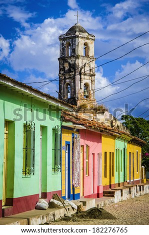 Colorful traditional houses and old church tower in the colonial town of Trinidad in Cuba  - stock photo