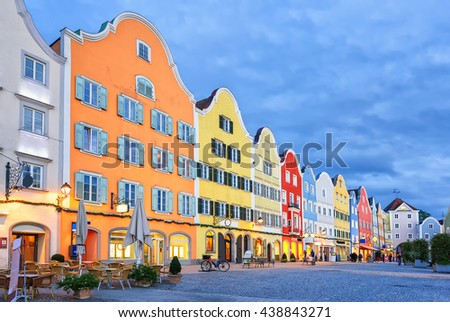 Colorful traditional houses in gothic old town Scharding, Upper Austria, in the evening