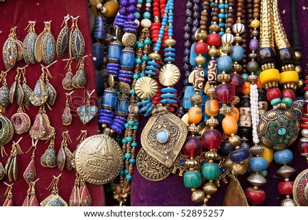 colorful traditional indian jewelry sold at weekly market in Anjuna, Goa ( India) - stock photo