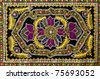 Colorful traditional oriental carpet on wall - stock photo