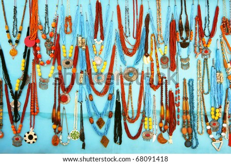 colorful traditional vintage necklace on blue background - stock photo