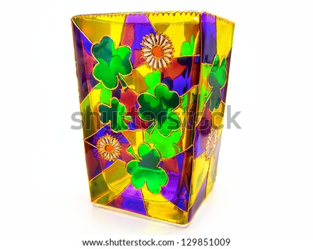 Colorful transparent stained glass Irish shamrock / clover / Ireland and daisies flower vase / candle holder / St. Patrick's Day - stock photo