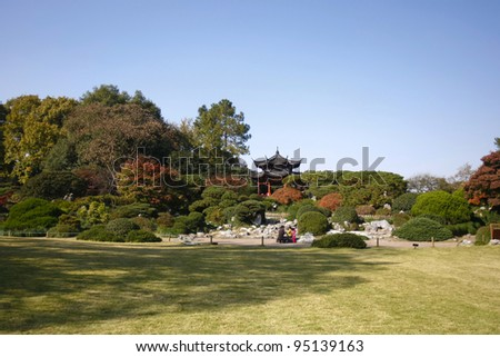 Colorful trees and green parks of the West Lake in Hangzhou, China. - stock photo