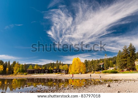 Colorful trees in fall with interesting sky at Lake Tahoe, California - stock photo