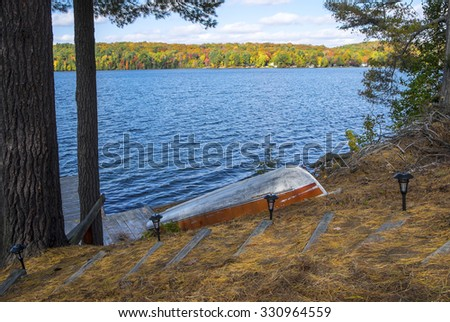 Colorful Trees in the Fall by a Lake - stock photo