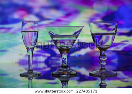 Colorful Trio of Uniquely Shape Glasses - stock photo