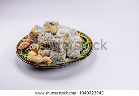 Beautiful Traditional Eid Al-Fitr Feast - stock-photo-colorful-turkish-delight-lokum-with-nuts-on-plate-a-traditional-eid-al-fitr-sweet-1040323945  Collection_37682 .jpg