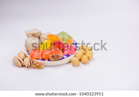 Download Turkey Eid Al-Fitr Food - stock-photo-colorful-turkish-delight-lokum-with-nuts-on-plate-a-traditional-eid-al-fitr-sweet-1040323951  Pictures_8497 .jpg