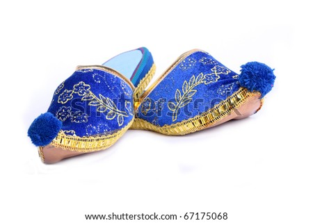 Colorful Turkish slippers on white - stock photo