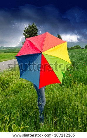 Colorful Umbrella against Sky in Tuscany Countryside