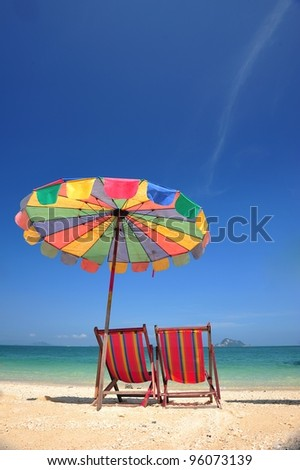 Colorful umbrella and beach - stock photo