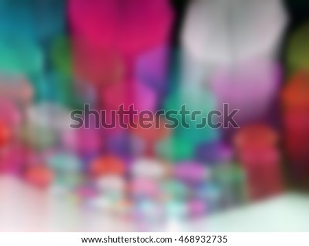 Colorful umbrella hanging overhead,Blurred image for background