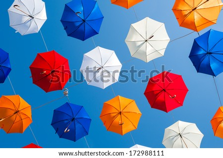 Colorful umbrellas and colorful background - stock photo