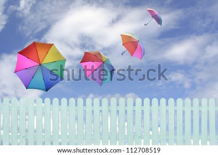 colorful umbrellas flying in a rich blue sky.conceptual image. - stock photo
