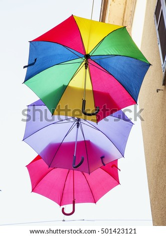 Colorful umbrellas flying in the sky, vertical image