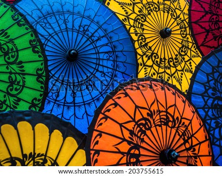 Colorful umbrellas on display at traditional street market in Bagan, Mandalay Region, Myanmar (Burma).  - stock photo