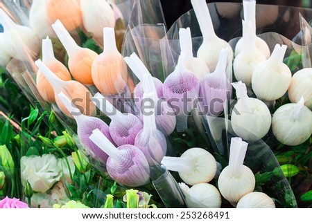 colorful variety of flowers sold in the market - stock photo