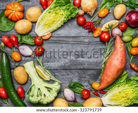Colorful various of organic farm vegetables on light blue wooden background, top view. Healthy foods, cooking and vegetarian concept. - stock photo