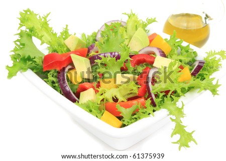 Colorful vegetable salad: onions, peppers, lettuce. Isolated food.