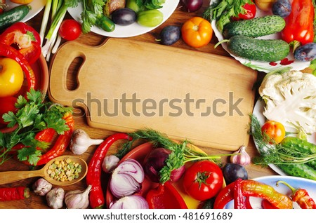 Colorful  vegetables and kitchen board
