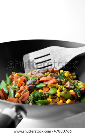 colorful vegetables in a black and white environment