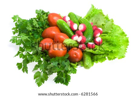 Colorful vegetables on plate: tomato, parsley, radish, lettuce. Isolated.