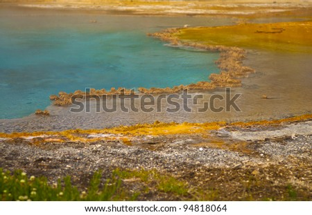 Colorful vibrant shot of a yellowstone geyser - stock photo