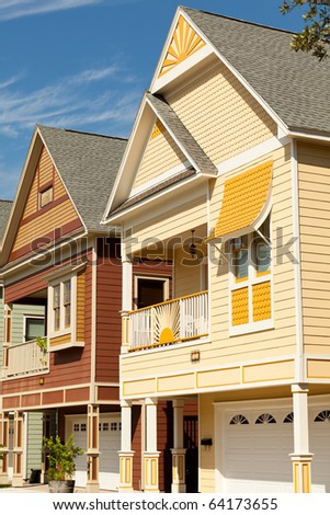Colorful Victorian style homes. - stock photo