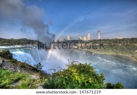 Colorful view of Niagara Falls and rainbow - stock photo
