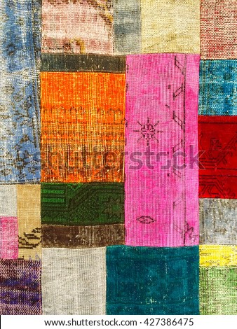 Colorful vintage patchwork rug with ethnic design.