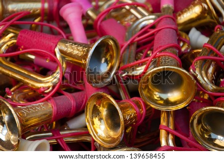 Colorful vintage toy trumpets at flea market. - stock photo