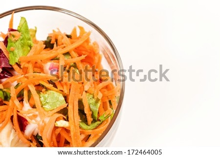 Colorful vitamin salad in glass bowl.