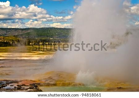 Colorful vivid horizontal shot of a erupting yellowstone geyser - stock photo