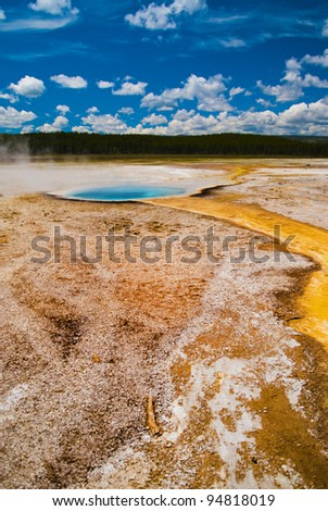 Colorful vivid vertical shot of a yellowstone geyser - stock photo