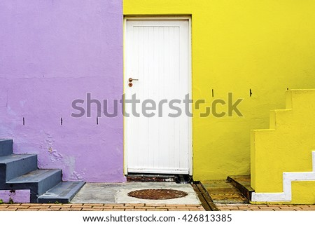Colorful walls and white door in Cape Town, South Africa