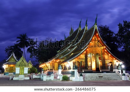 Colorful Wat Xieng thong temple at dusk in Luang pra bang, Loas - stock photo