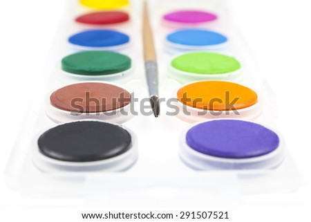 Colorful water colors and brushes. - stock photo